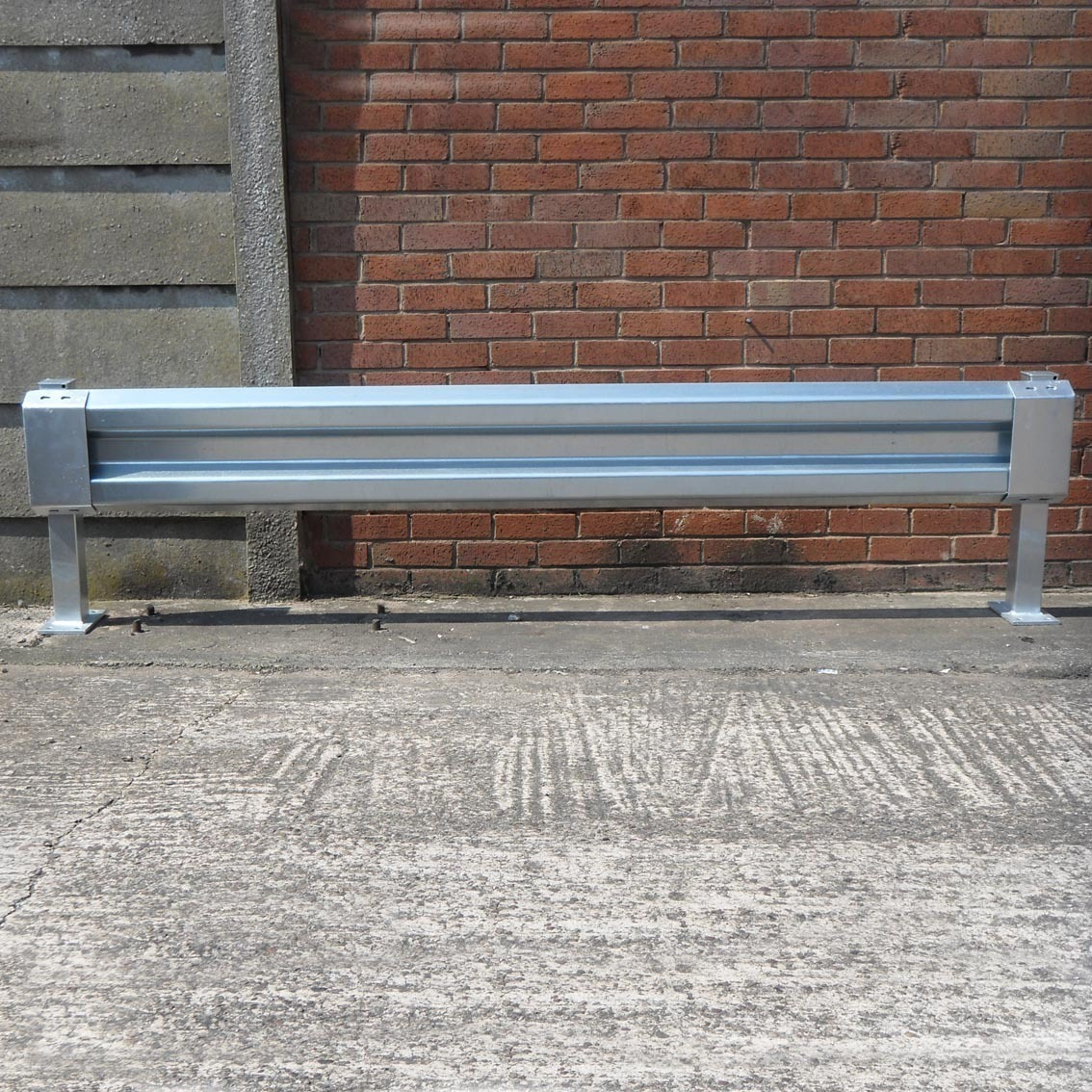 Sectional steel barrier with pedestrian friendly ends