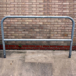 Motor Cycle Security Barrier. Loose steel bar inserted to prevent cutting and hacksawing